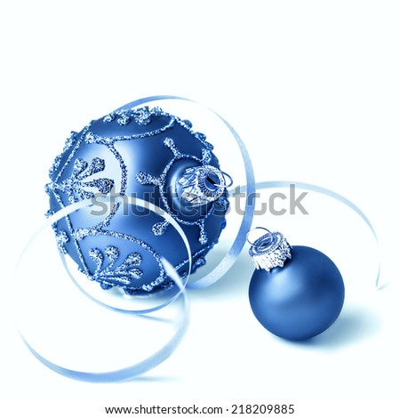 Dark blue glass Christmas baubles on white background  - stock photo
