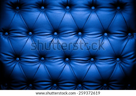 Dark blue leather texture background with buttoned pattern - stock photo
