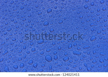 Dark blue metallic paint with water drops short focal range for backgrounds - stock photo