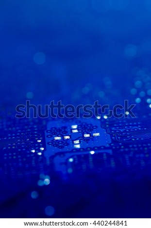 dark blue pcb board integrated circuit pc parts motherboard chip texture background - stock photo