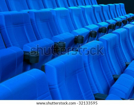 Dark blue rows of theater seats - stock photo