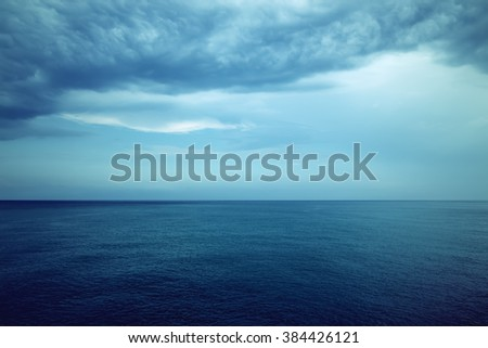 Dark blue sea and stormy clouds. Mediterranean nature. - stock photo