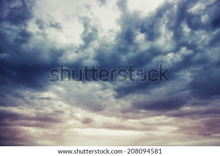 Dark blue stormy cloudy sky natural photo background with Instagram toned effect - stock photo