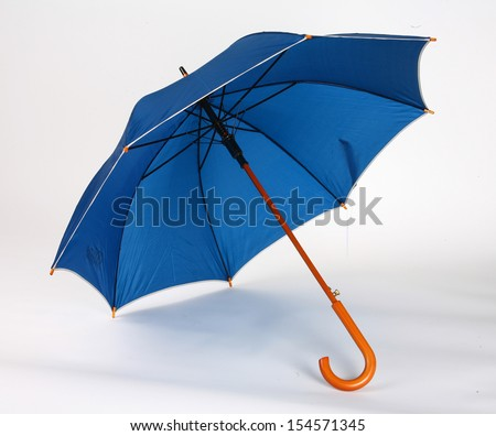 Dark blue umbrella / studio photo of opened umbrella - on white background  - stock photo
