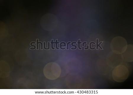 Dark bokeh with smoke for nightlife concept - stock photo