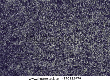 Dark boucle texture. Toned filtered image in instagram style - stock photo