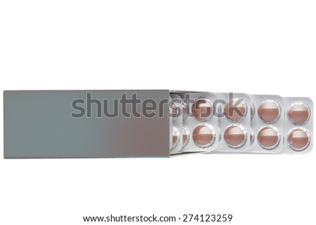 Dark box with brown pills in a blister pack on an isolated background - stock photo