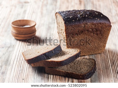 dark bread on old wooden background