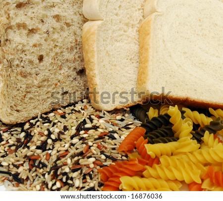 Dark bread white bread rice and pasta - stock photo