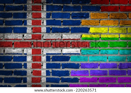 Dark brick wall texture - coutry flag and rainbow flag painted on wall - Iceland