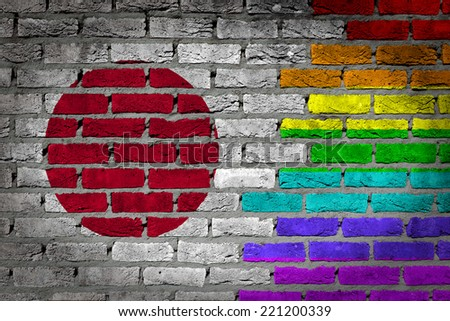 Dark brick wall texture - coutry flag and rainbow flag painted on wall - Japan - stock photo