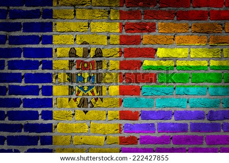 Dark brick wall texture - coutry flag and rainbow flag painted on wall - Moldova