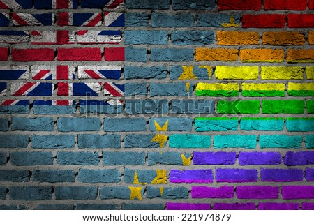 Dark brick wall texture - coutry flag and rainbow flag painted on wall - Tuvalu - stock photo