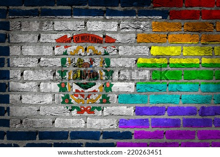Dark brick wall texture - coutry flag and rainbow flag painted on wall - West Virginia - stock photo