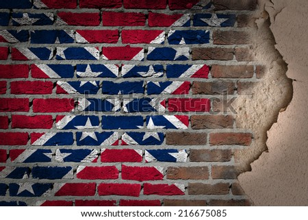 Dark brick wall texture with plaster - flag painted on wall - Confederate flag - stock photo