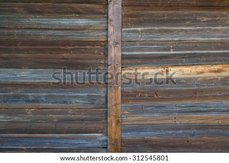Dark brown and weathered wooden gate texture - stock photo