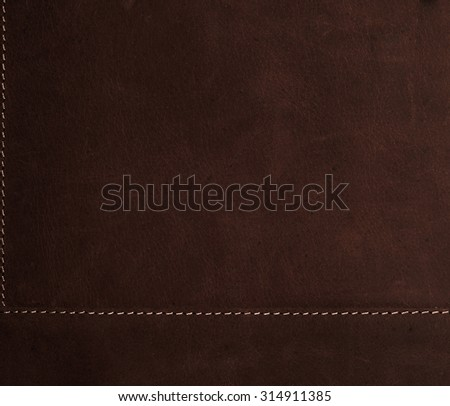 dark brown background stitched leather texture - stock photo