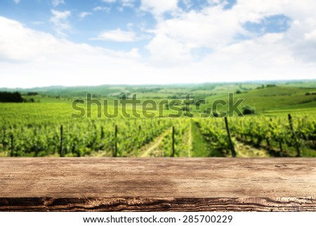 dark brown desk top and green landscape  - stock photo