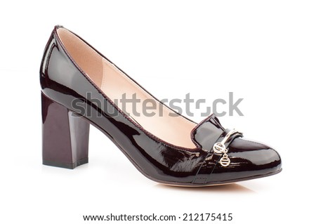 Dark brown glossy women shoe isolated on white background.