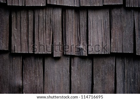 Dark brown house shingles - stock photo