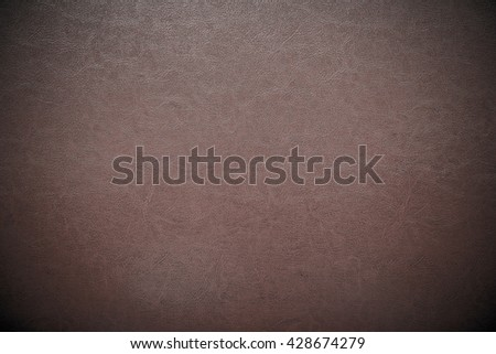 dark brown leather texture closeup can be used as background. - stock photo