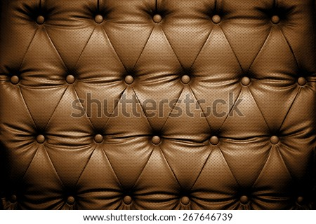 Dark brown leather texture with buttoned pattern - stock photo