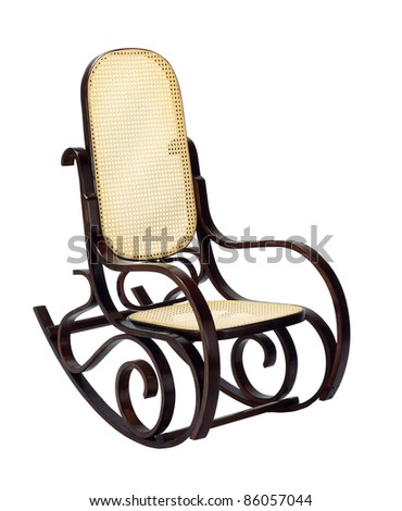 dark brown rocking chair with yellow braided back and seat - stock photo