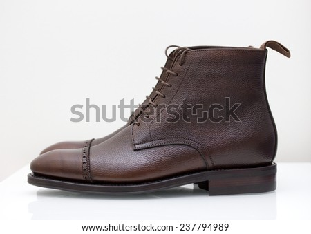 dark brown scotch grain leather boots side view - stock photo