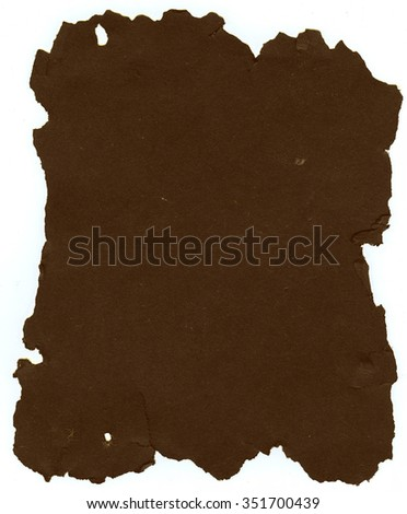 Dark brown sheet of old torn paper