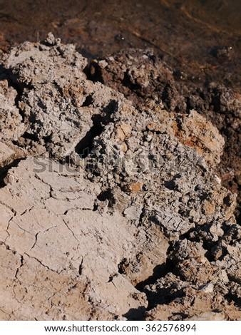 Dark brown sun dried mud clay stock photo 362576894 shutterstock dark brown sun dried mud clay broken earth surface texture on a shrimp farm thailand view preview sciox Images