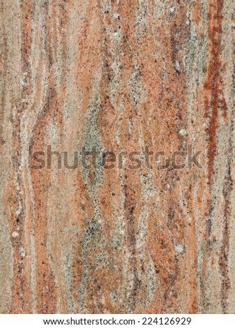 dark brown with beige red and gray striped patterned large smooth granite marble stone  - stock photo