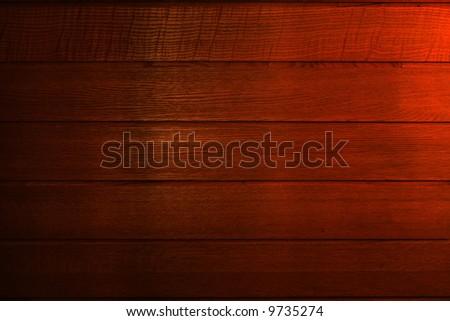 Dark brown wood background. Fragment of indoor boarding - stock photo