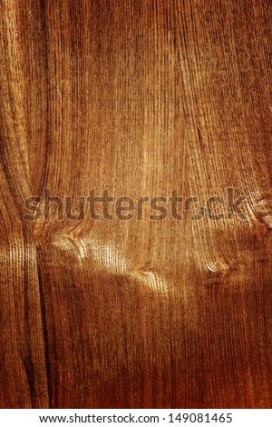 Dark brown wood with knots as a background - stock photo