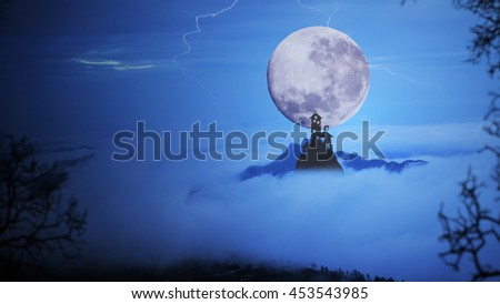 Dark castle with dramatic sky,fog, tree, full moon and clouds over mountain. Cool blue tone. - stock photo