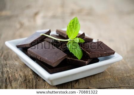 Dark chocolate blocks with fresh mint leaves - stock photo