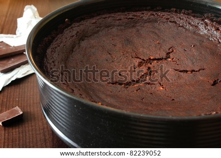 Dark chocolate cake on a wooden table - stock photo