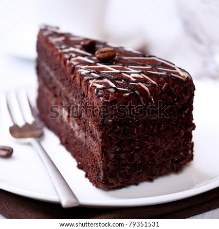 Dark chocolate cake with coffee beans - stock photo