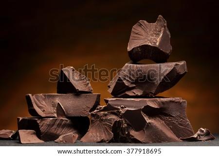 Dark chocolate / Chocolate chunks isolated / Chocolate bar pieces - stock photo