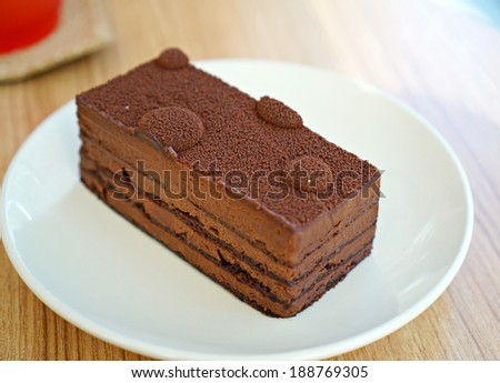 Dark Chocolate Mousse on white plate  - stock photo