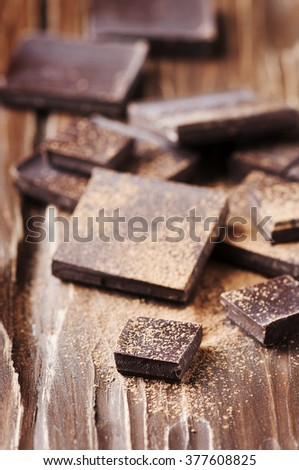 Dark chocolate on the wooden table, selective focus