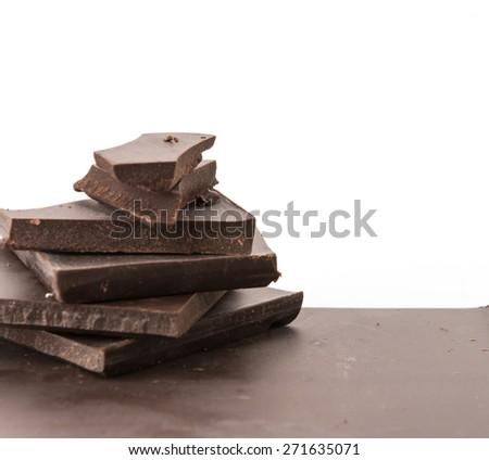 dark chocolate on white background - stock photo