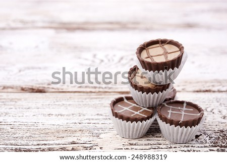 Dark chocolate on wooden background - stock photo