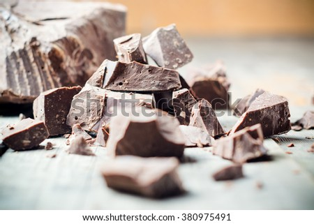 Dark chocolate pieces , chocolate candy, cocoa. Shallow DOF - stock photo