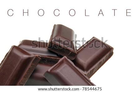 Dark chocolate pieces on white background - stock photo