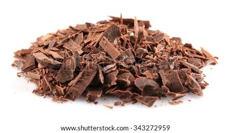 Dark chocolate shavings isolated on white - stock photo