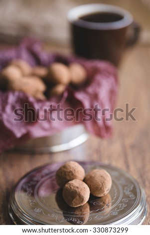 Dark chocolate truffles with cocoa powder - stock photo