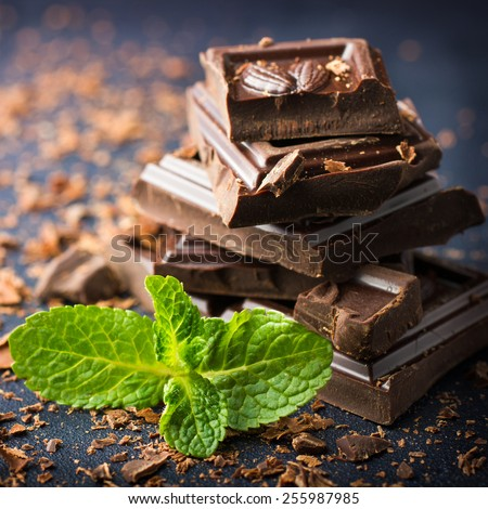Dark chocolate with mint leaf, square  image - stock photo