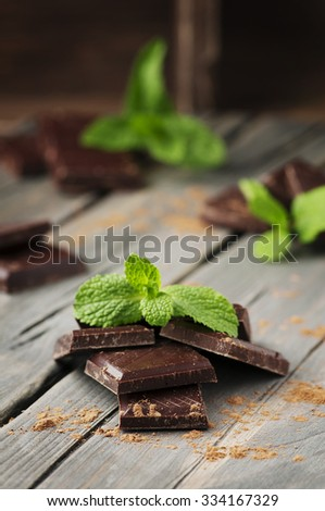 Dark chocolate with mint on the vintage table, selective focus