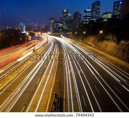 dark city highway motor road with blurred long exposure vehicle light lane cityscape twilight movement - stock photo