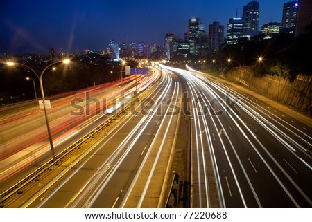 dark city highway motor road with blurred long exposure vehicle light lane cityscape twilight movement